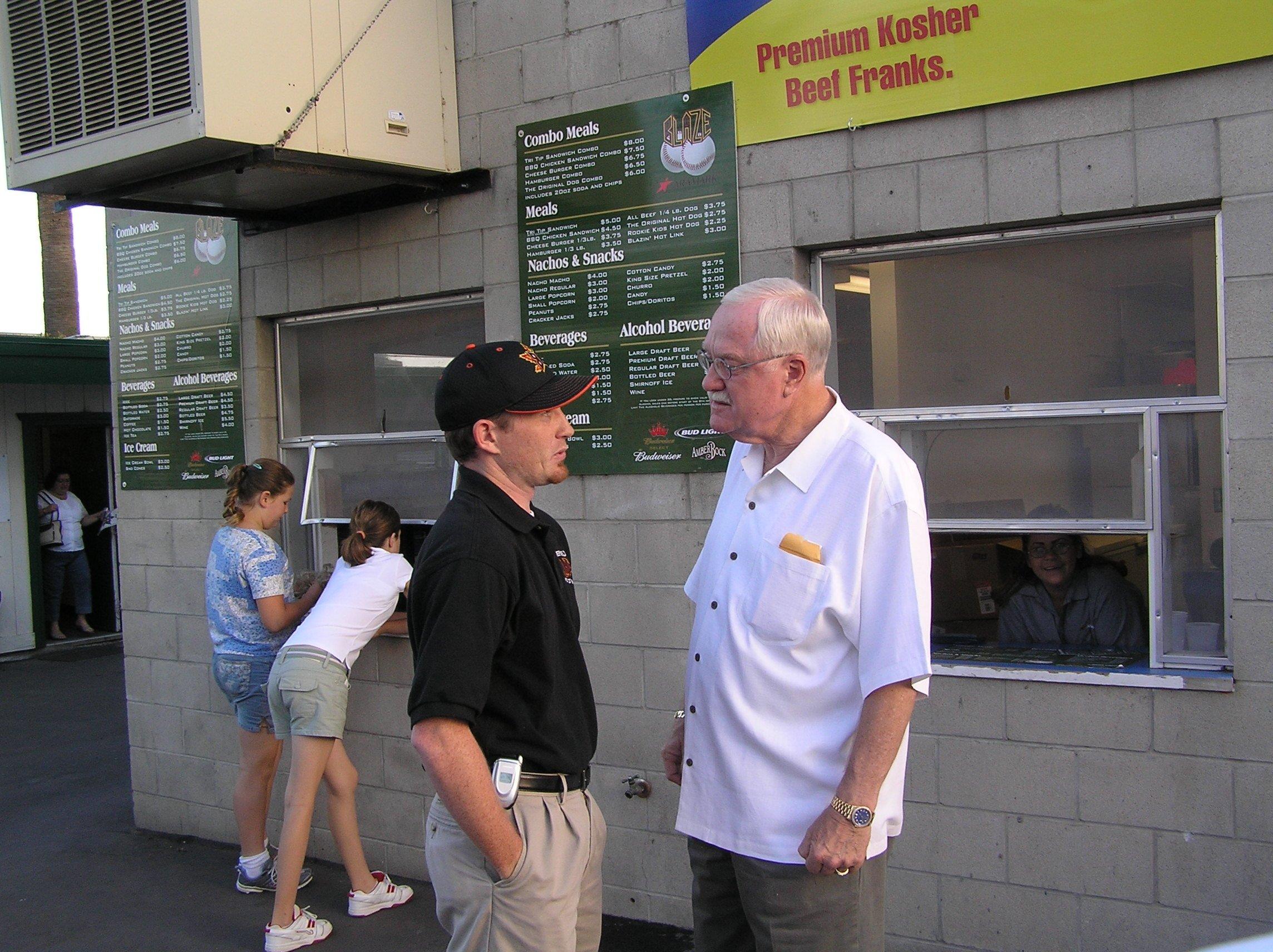 Brian and former Bakersfield mayor Harvey Hall talking baseball at a Bakersfield Blaze game.